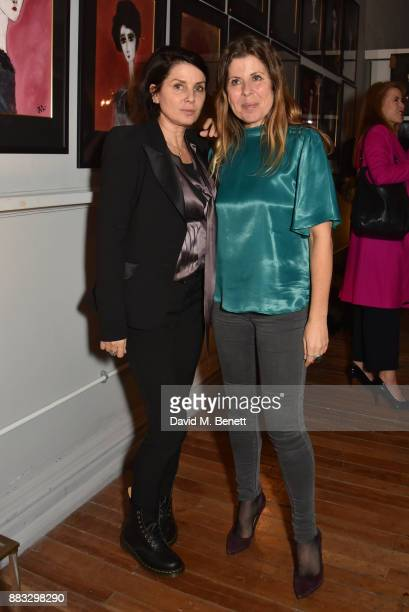 Sadie Frost and Rebecca Leigh attend a private view of artist Rebecca Leigh's exhibition hosted by Sadie Frost at Tann Rokka on November 30 2017 in...