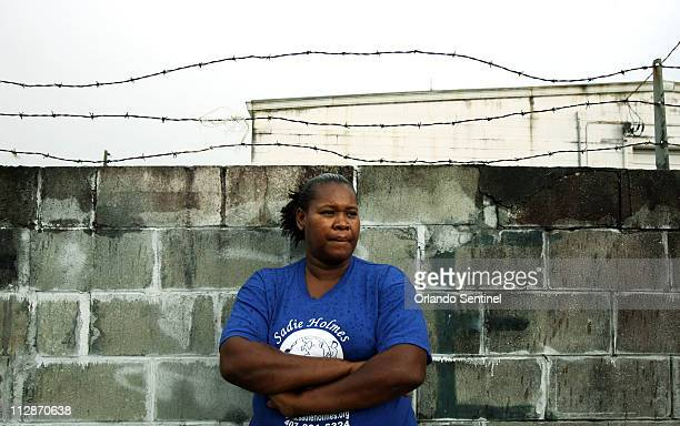 Sadie Holmes of Altamonte Springs poses along a wall in her neighborhood across from her house June 25 2008 Holmes had her home made over two years...