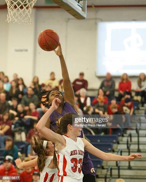 Sadie Lyons of Cheverus puts up a shot over Madeline Hasson of South Portland during a Western Class A girls quarterfinal basketball game at the...