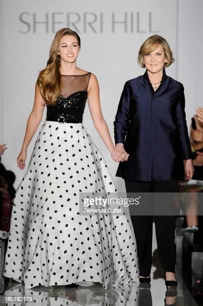 Sadie Robertson and Sherri Hill walk the runway at an Evening By Sherri Hill fashion show during MercedesBenz Fashion Week Spring 2014 at Trump Tower...