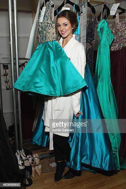 Sadie Robertson prepares backstage at the Sherri Hill fashion show during MercedesBenz Fashion Week Fall 2015 at The Plaza on February 19 2015 in New...