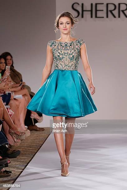 Sadie Robertson walks the runway at the Sherri Hill fashion show during MercedesBenz Fashion Week Fall 2015 at The Plaza on February 19 2015 in New...