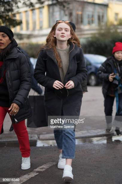 Sadie Sink is seen on the street attending Undercover during Paris Fashion Week Women's A/W 2018 Collection wearing a grey wool coat sweater and blue...