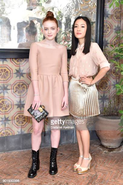 Sadie Sink, wearing Dior, and Constance Wu attends Lynn Hirschberg Celebrates W Magazine's It Girls With Dior at A.O.C on January 6, 2018 in Los...
