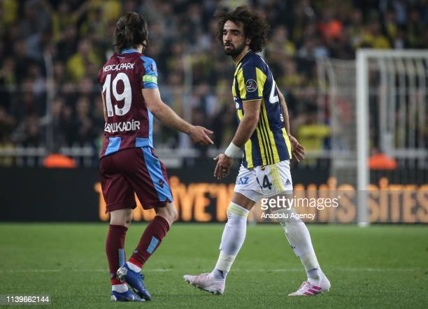 Sadik Ciftpinar of Fenerbahce goes out of play after seeing a red card during Turkish Super Lig week 30 soccer match between Fenerbahce and...