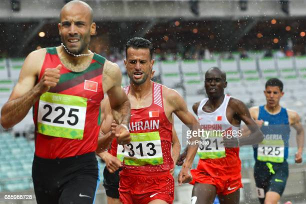 Sadik Mikhou of Bahrain controles the race behind Fouad Elkaam of Morocco in Men's 1500m final during day five of Athletics at Baku 2017 4th Islamic...