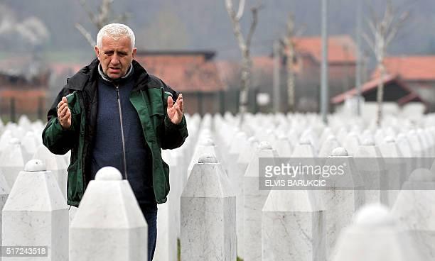 Sadik Selimovic a survivor of July 1995 massacre in Srebrenica prays by his relatives' grave at a memorial center in Potocari on March 24 2016 Former...
