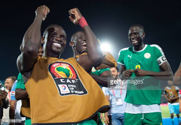 Sadio Mané and Cheikhou Kouyate of Senegal celebrate victory after winning the 2019 Africa Cup of Nations Semi Final match between Senegal and...