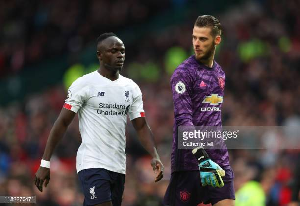 Sadio Mané of Liverpool and David De Gea of Manchester United chat during the Premier League match between Manchester United and Liverpool FC at Old...