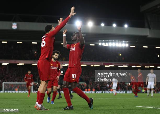 Sadio Mané of Liverpool celebrates after scoring his sides third goal with Trent Alexander-Arnold of Liverpool during the Premier League match...