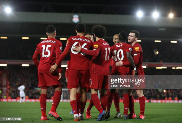 Sadio Mané of Liverpool celebrates after scoring his sides third goal during the Premier League match between Liverpool FC and West Ham United at...