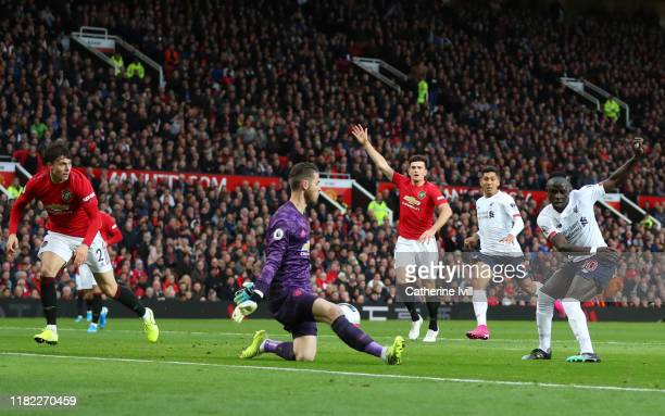 Sadio Mané of Liverpool scores his sides first goal only for it to be disallowed during the Premier League match between Manchester United and...