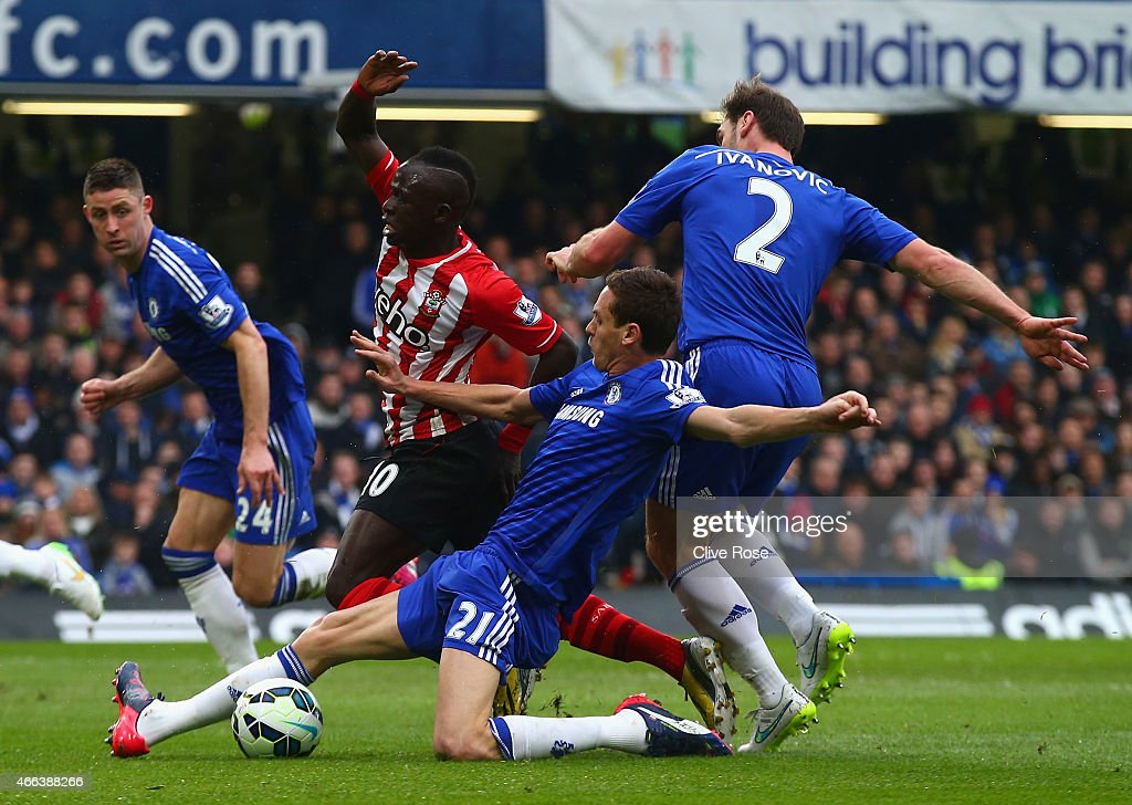 Sadio Mané of Southampton is brought down bv Nemanja Matic of Chelsea to win a penalty during the Barclays Premier League match between Chelsea and Southampton at Stamford Bridge on March 15, 2015 in London, England.