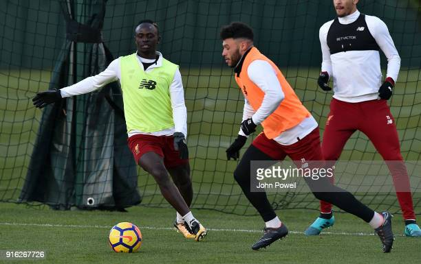 LIVERPOOL ENGLAND FEBRUARY 09 Sadio Mane and Alex OxladeChamberlain of Liverpool during a training session at Melwood Training Ground on February 9...