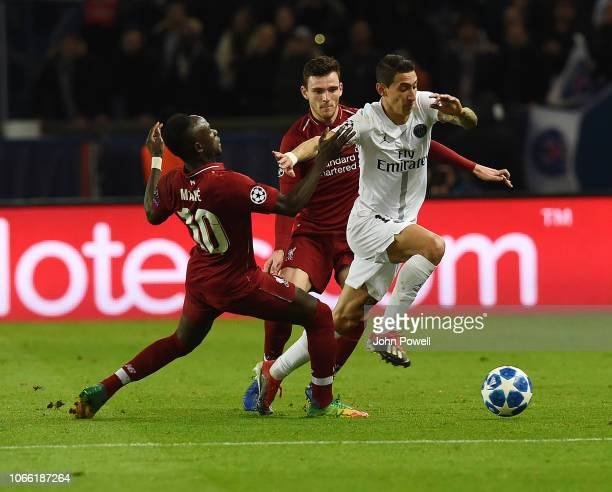 Sadio Mane and Andrew Robertson of Liverpool with Angel Di Maria of Paris SaintGermain during the Group C match of the UEFA Champions League between...