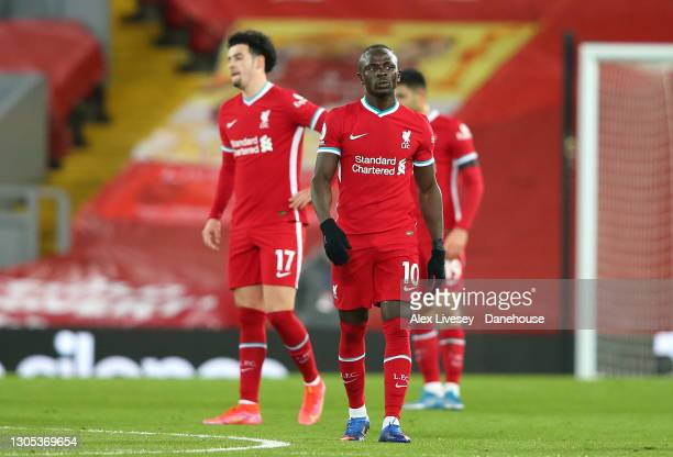 Sadio Mane and Curtis Jones of Liverpool look on after conceding the opening goal during the Premier League match between Liverpool and Chelsea at...