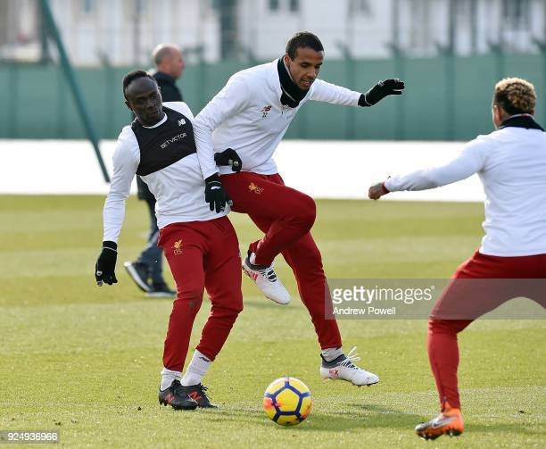 Sadio Mane and Joel Matip of Liverpool during a training session at Melwood Training Ground on February 27 2018 in Liverpool England