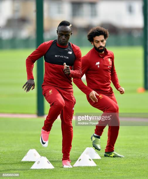 Sadio Mane and Mohamed Salah of Liverpool during a training session at Melwood Training Ground on August 25 2017 in Liverpool England
