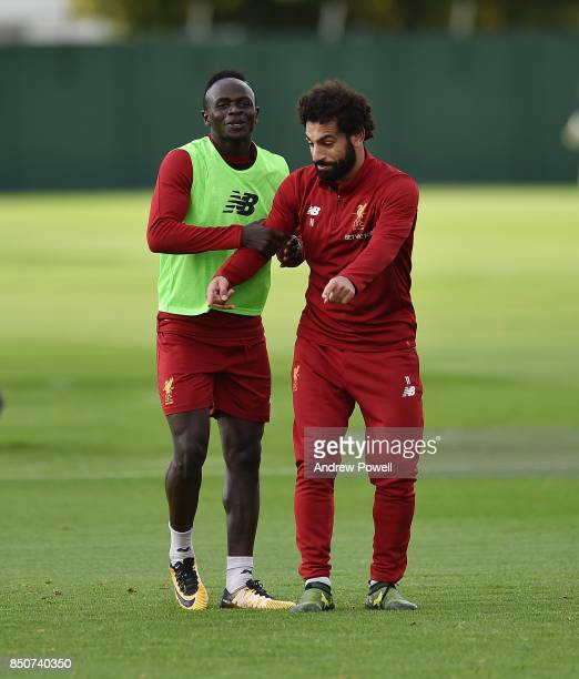 Sadio Mane and Mohamed Salah of Liverpool during a training session at Melwood Training Ground on September 21 2017 in Liverpool United Kingdom