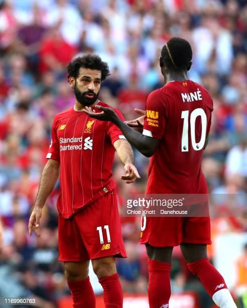 Sadio Mane and Mohamed Salah of Liverpool interact during the Premier League match between Liverpool FC and Arsenal FC at Anfield on August 24 2019...