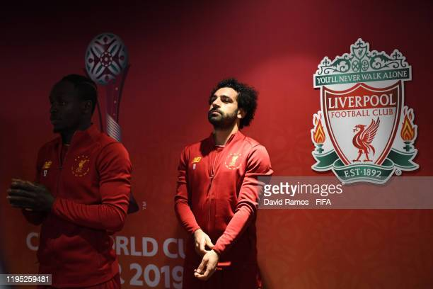 Sadio Mane and Mohamed Salah of Liverpool look on inside the tunnel ahead of the FIFA Club World Cup Qatar 2019 Final match between Liverpool FC and...