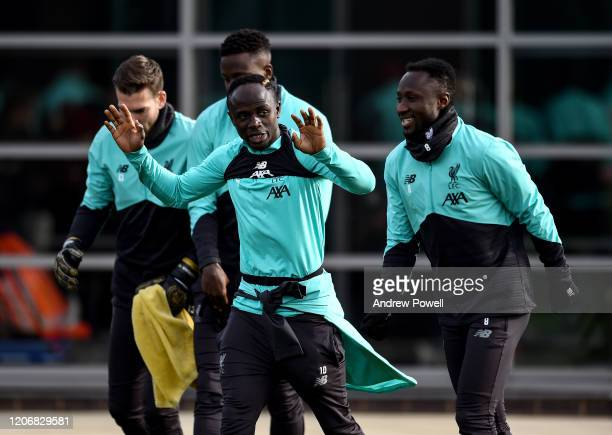 Sadio Mane and Naby Keita of Liverpool during a training session at Melwood training ground on February 17 2020 in Madrid Spain