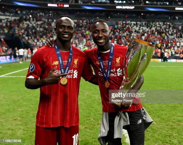 Sadio Mane and Naby Keita of Liverpool with the UEFA Super Cup trophy at the end of the UEFA Super Cup match between Liverpool and Chelsea at...