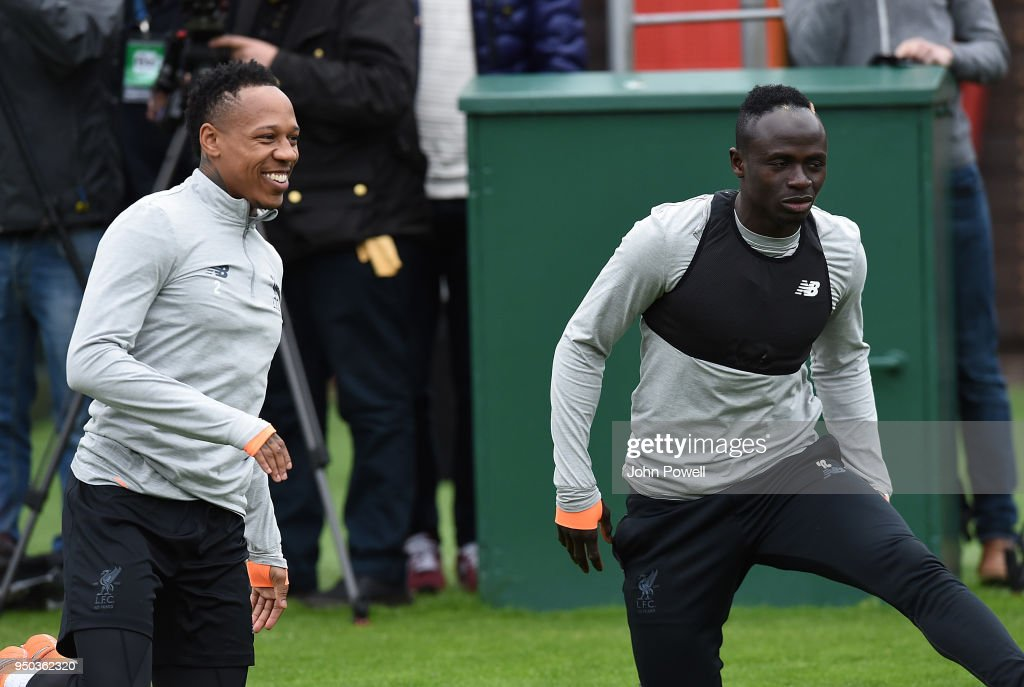 Sadio Mane and Nathaniel Clyne of Liverpool during a training session at Melwood Training Ground on April 23, 2018 in Liverpool, England.