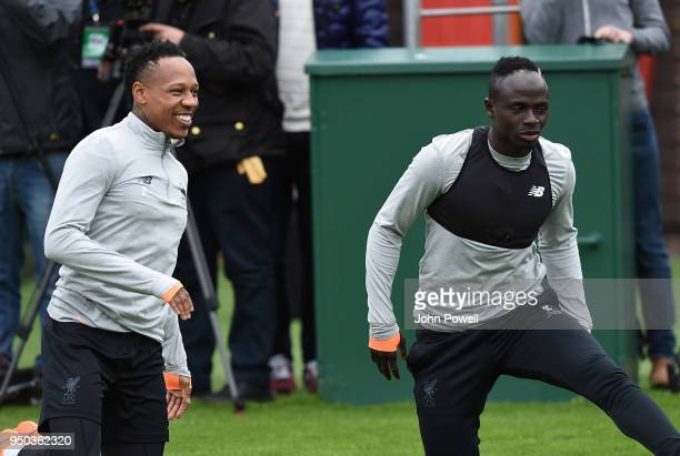 Sadio Mane and Nathaniel Clyne of Liverpool during a training session at Melwood Training Ground on April 23 2018 in Liverpool England