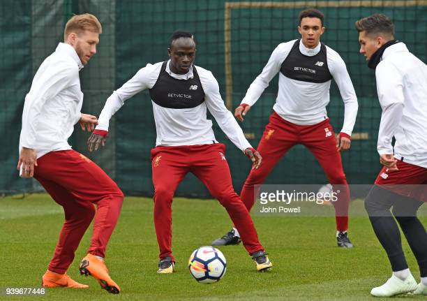 Sadio Mane and Ragnar Klavan of Liverpool during a training session at Melwood Training Ground on March 29 2018 in Liverpool England