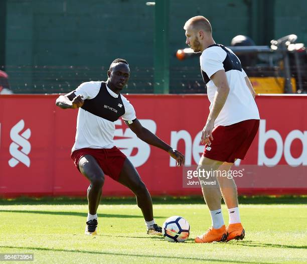 Sadio Mane and Ragnar Klavan of Liverpool during a training session at Melwood Training Ground on May 4 2018 in Liverpool England