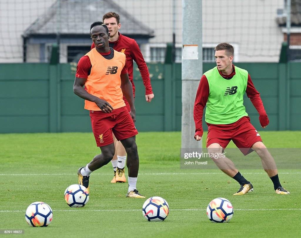 Sadio Mane and Ryan Kent of Liverpool during a training session at Melwood Training Ground on August 10, 2017 in Liverpool, England.
