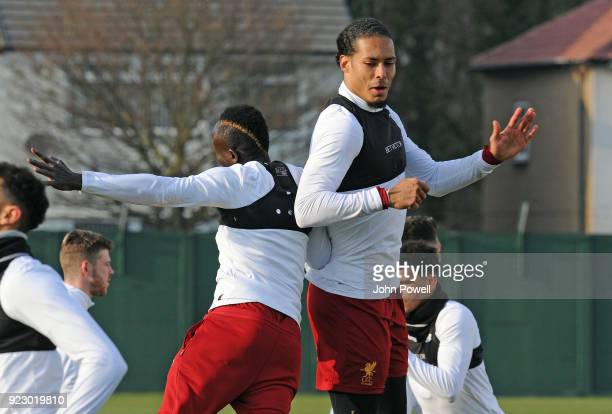 Sadio Mane and Virgil van Dijk of Liverpool during a training session at Melwood Training Ground on February 22 2018 in Liverpool England