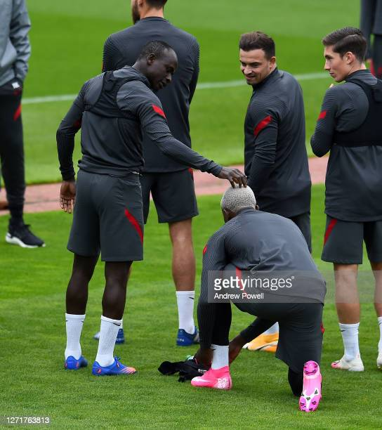 Sadio Mane and Xherdan Shaqiri with Divock Origi of Liverpool during a training session at Melwood Training Ground on September 10 2020 in Liverpool...