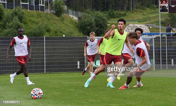 Sadio Mane, Curtis Jones and Kostas Tsimikas of Liverpool during a training session on July 25, 2021 in UNSPECIFIED, Austria.