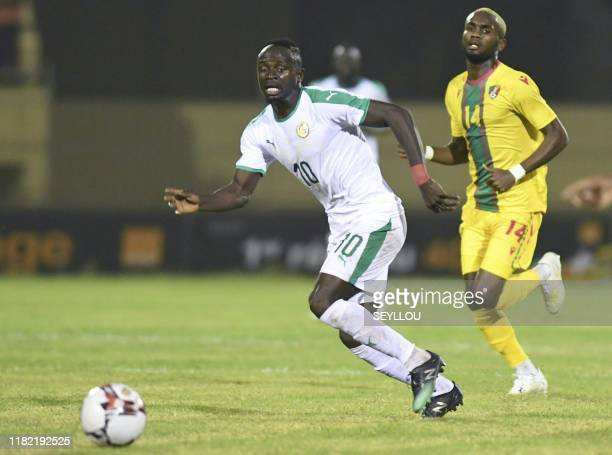 Sadio Mane from Senegal runs with the ball from a Congolese player at the Lat-Dior stadium in Thies, Senegal, November 13, 2019 during a qualifying...