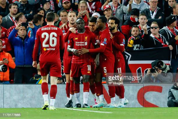 Sadio Mane of FC Liverpool celebrates after scoring his team's first goal with team mates during the UEFA Champions League group E match between...