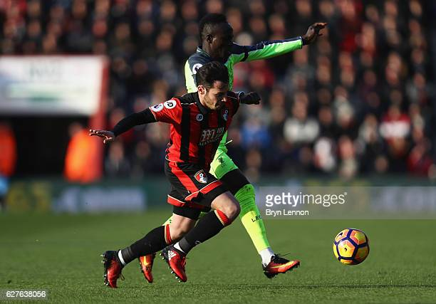 Sadio Mane of Liverpool and Adam Smith of AFC Bournemouth battle for the ball during the Premier League match between AFC Bournemouth and Liverpool...