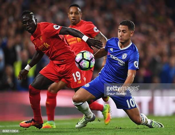 Sadio Mane of Liverpool and Eden Hazard of Chelsea battle for the ball during the Premier League match between Chelsea and Liverpool at Stamford...