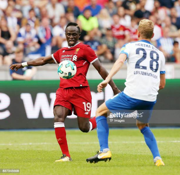 Sadio Mane of Liverpool and Fabian Lustenberger of Hertha battle for the ball during the Preseason Friendly match between Hertha BSC and FC Liverpool...