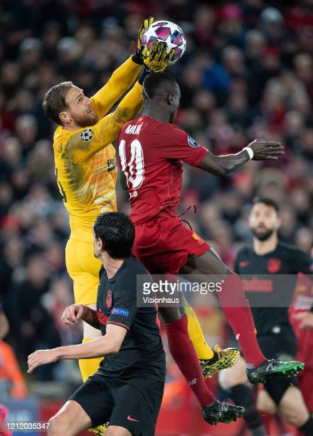 Sadio Mane of Liverpool and goalkeeper Jan Oblak of Atletico Madrid during the UEFA Champions League round of 16 second leg match between Liverpool...