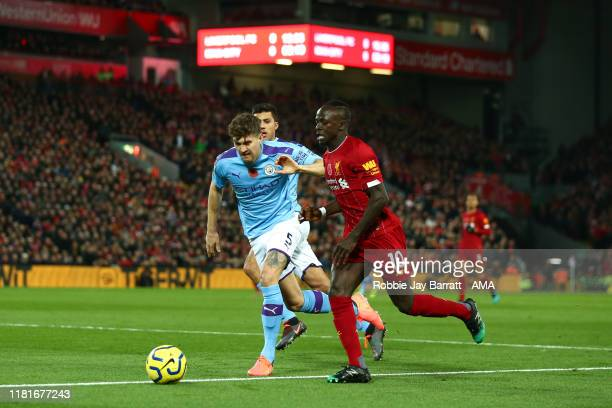 Sadio Mane of Liverpool and John Stones of Manchester City during the Premier League match between Liverpool FC and Manchester City at Anfield on...