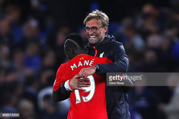 Sadio Mane of Liverpool and Jurgen Klopp Manager of Liverpool celbrate victory in the Premier League match between Chelsea and Liverpool at Stamford...