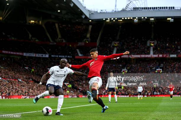 Sadio Mane of Liverpool and Marcos Rojo of Manchester United during the Premier League match between Manchester United and Liverpool FC at Old...