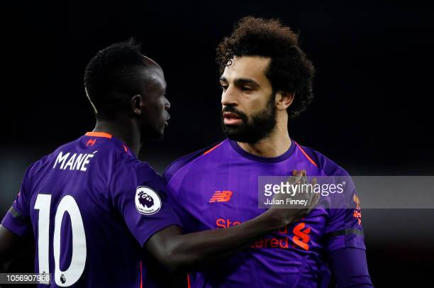 Sadio Mane of Liverpool and Mohamed Salah of Liverpool look on during the Premier League match between Arsenal FC and Liverpool FC at Emirates...