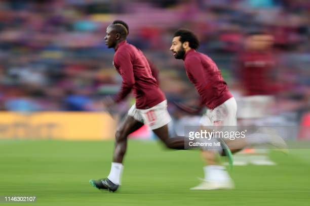 Sadio Mane of Liverpool and Mohamed Salah of Liverpool warm up ahead of the UEFA Champions League Semi Final first leg match between Barcelona and...