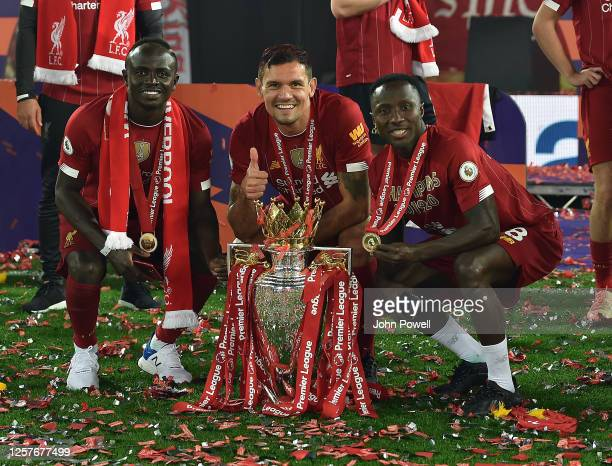 Sadio Mane of Liverpool and Naby Keita of Liverpool and Dejan Lovren of Liverpool with the Premiership Trophy the Premier League match between...