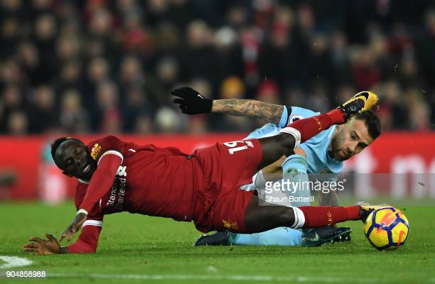Sadio Mane of Liverpool and Nicolas Otamendi of Manchester City in action during the Premier League match between Liverpool and Manchester City at...
