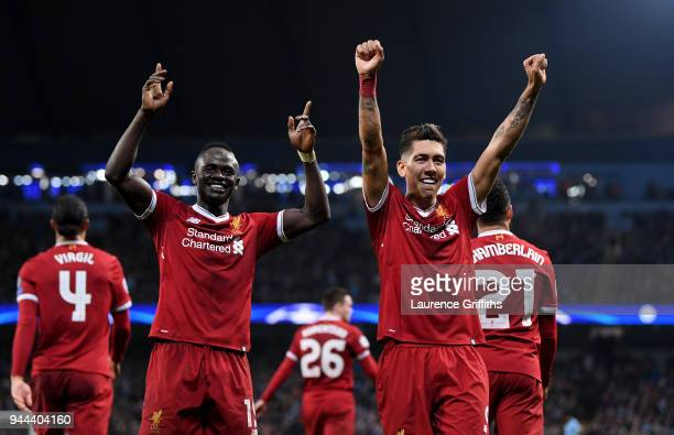 Sadio Mane of Liverpool and Roberto Firmino of Liverpool celebrate at the full time whistle during the UEFA Champions League Quarter Final Second Leg...