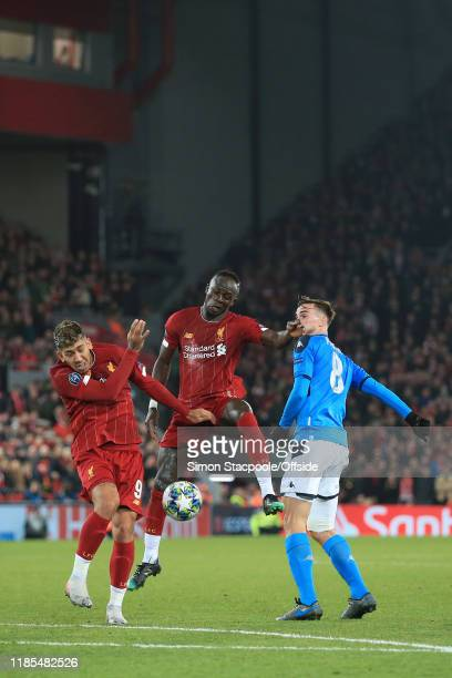 Sadio Mane of Liverpool and Roberto Firmino of Liverpool combine to shut out Fabian of Napoli during the UEFA Champions League group E match between...